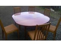 Large extending dining table and six upholstered chairs