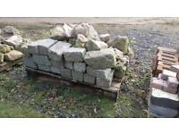 Two pallets of rocks including some granite sets
