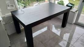 Large dark brown dining table with 4 chairs