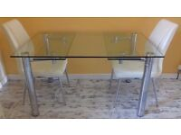 Solid glass and chrome dining table with 4 chairs.