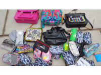 Job lot of various bags and pencil cases all new but some of the bags require a strap repair