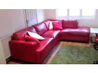 Red leather corner piece sofa