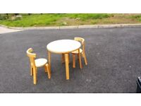 Wooden Children's table and 2 chairs