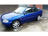 Ford escort no leaks from roof rust in all usual places water pump issues smoking MOT'd still drives