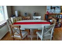 Ikea White round to oval table with 6 chairs and cushions