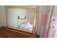 Gold coloured bevelled wall mirror
