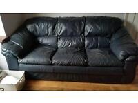 Dark blue leather sofas