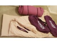 2 single Duvalay sleeping bags in very good condition, includes memory foam, removable covers & bags