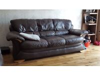 3 seater sofa brown in colour