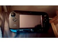 nintendo wii u with 3 figures and 2 games