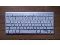 Apple 1314 wireless keyboard and an Apple M5769 Mouse