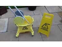 Cleaning Mop Bucket on wheels and Sign