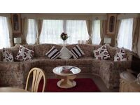 Static caravan for hire in Mid Wales sleeps 6,recently refurbished with new carpets throughout.