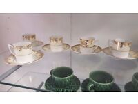 Five Gold and White Coffee Cups and Saucers