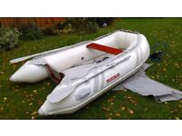 Suzuma by Suzuki 265 air deck inflatable with 2 stroke Mariner 2.5 HP outboard