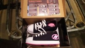 Black and Pink childs Heelys