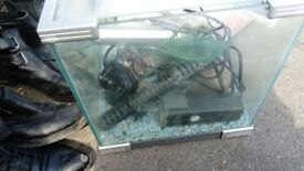 Tropical aquarium fish tank with light, pump, cleaner and net, gravel and rocks included