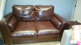 Leather 2 seater couch and footstool
