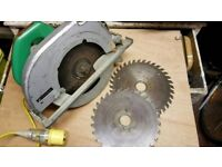 HITACHI SKILL SAW , 3 TUNGSTEN TIPPED BLADES , AND EXTENSION LEAD , 110 VOLT
