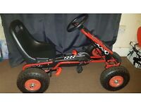 Motor racing style kids pedal go kart on rubber wheels