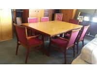 Large boardroom table and 6 red fabric chairs