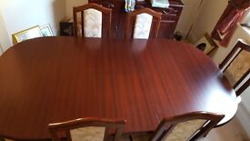 Dark wood 4-6 seated table with 6 chairs