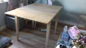 Wooden extending table