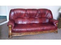 Beautiful red leather three seater sofa