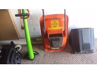 ELECTRIC LAWN MOWER AND STRIMMER COMES COMPLETE WITH GRASS BOX.