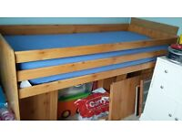 Sturdy wooden cabin bed.