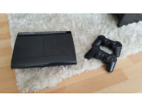 Perfect Condition PS3, 2 controllers, ps move, guitar and lot of games.