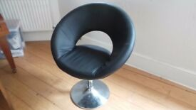 Set of Leather swivel chairs, 1 black, 1 white.