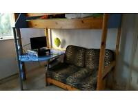 Bunk bed with sofa and desk