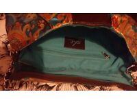 Multicoloured clutch bag