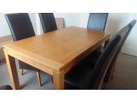 Solid wood dining room table (length 150cm) with 6 leather chairs.