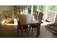 solid oak dining room table and four chairs