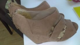 Brown swede wedge type shoe