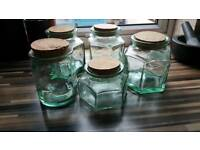 Five glass jars