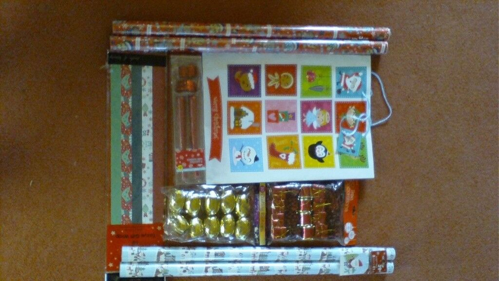 A selection of Christmas items-paper, tags, ribbon etc