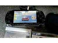 Psp with charger 3games 1dvd 512mb memory card