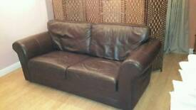 Brown imitation leather couch