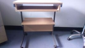 Small computer table with keyboard shelf and knee high shelf
