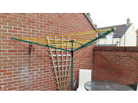 Rotary clothes airer in green and yellow
