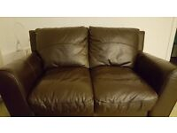 Dark Brown Leather Suite with 2 x 2 Seater couches plus Poufe with storage inside
