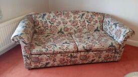 Sofa bed with floral print design. Small double size. Sturdy and in excellent condition.