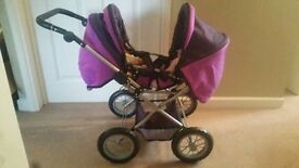 Purple double toy pram