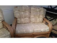 Conservatory suite from World of Wicker. Good quality wicker suite - 2 seater sofa and 2 chairs.