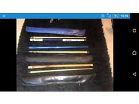 2 snooker cues and a pool cue