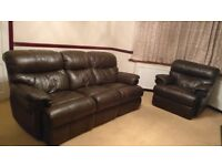 Sofa set for sale. Dark brown leather recliner 3 seater , 2 seater and single seater.Good condition.