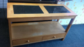 LOVELY WOOD CONSOLE TABLE WITH BLACK SPECKLED TOP INSERTS WITH 2 OPENING DRAWERS TO THE BASE